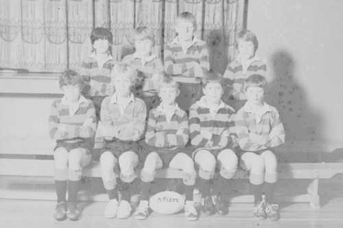 Football team photo restoration - before